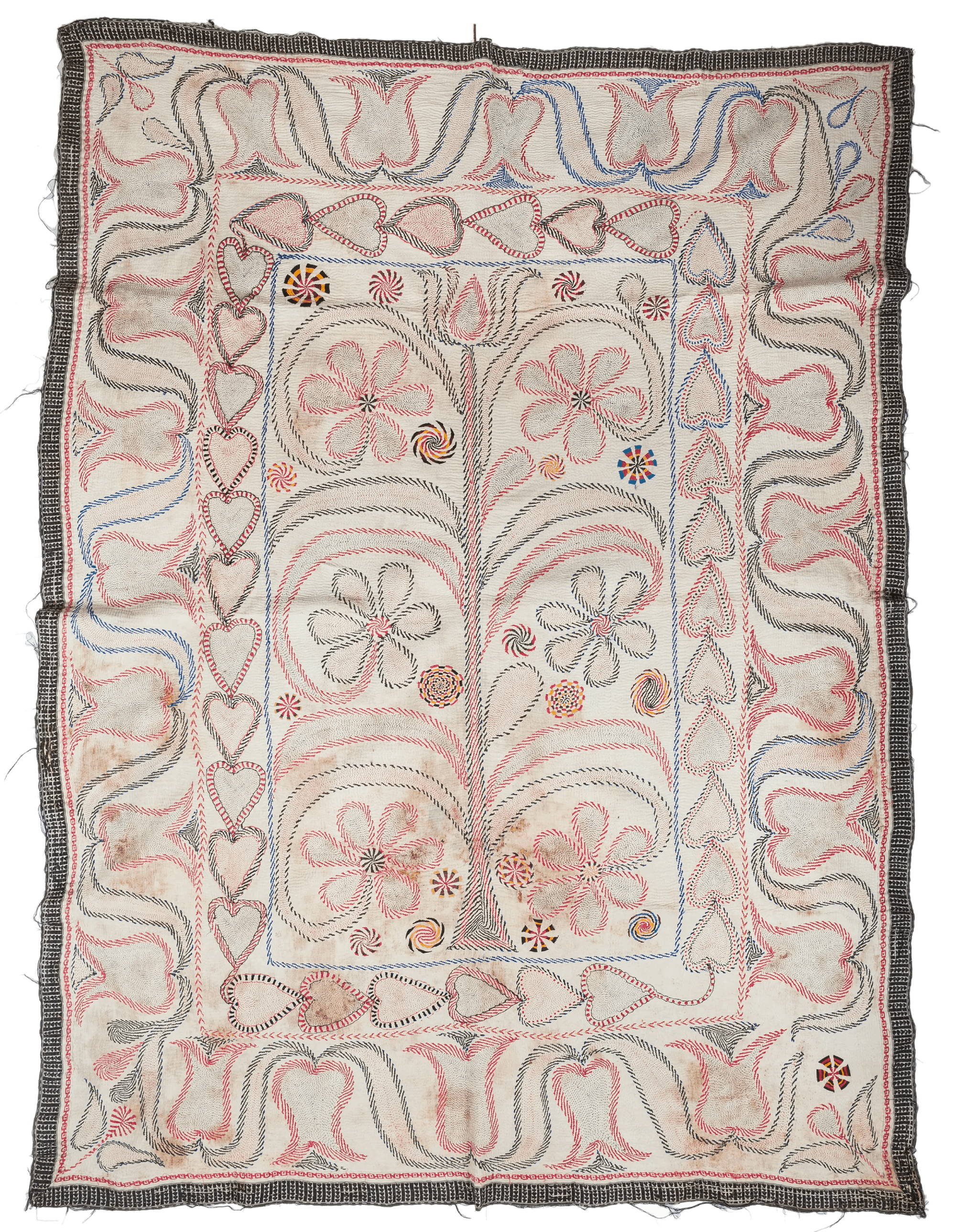 A kantha with black border, and red and black floral motifs